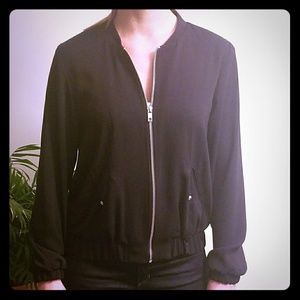 Perfect spring/fall bomber. Like new barely worn